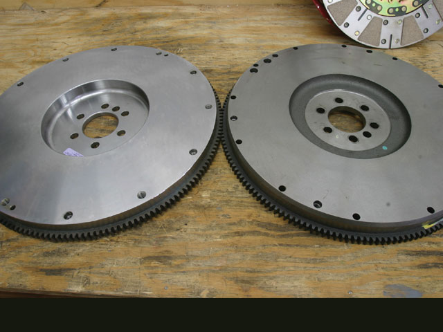 The McLeod adapter flywheel (left) offsets the distance to the flywheel friction surface rearward (toward the transmission) an additional 0.400 inch to make up for the shorter crank flange position on Gen III/IV engines. Note the Gen III/IV flywheel bolt pattern is smaller than the Gen I bolt pattern (right). The McLeod flywheel is relieved on the backside to maintain its 35-pound weight.