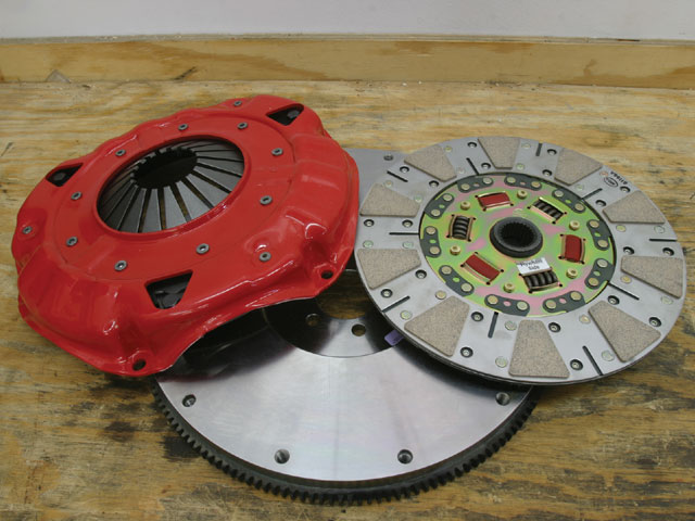 This is McLeod's street diaphragm pressure plate and clutch assembly designed for a late Muncie/Super T10 26-spline input shaft. The McLeod flywheel is drilled for two pressure plate bolt patterns. One pattern is for an 11-inch clutch assembly using shouldered 3/8x16 coarse thread bolts, while the second is for a metric 11-inch pressure plate using 10mm metric bolts. Be sure to match the older-style pressure plate with the traditional 3/8-inch bolt pattern.