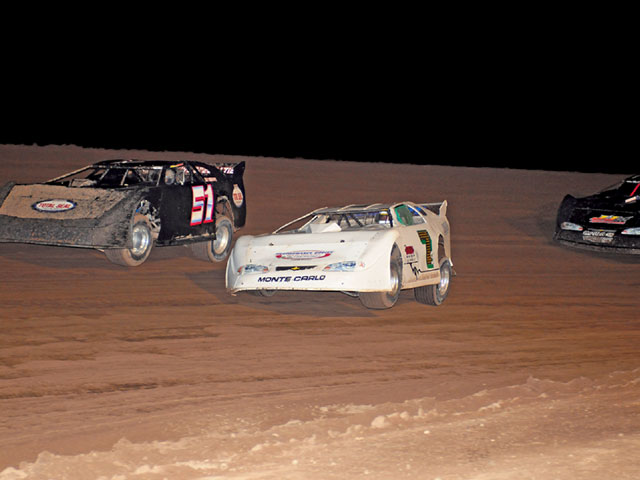 This is the same track, Central Arizona Raceway, but this photo was taken during the feature. Note how different the track is. While still wet, the chunks of flying mud are gone and the track surface is on its way to being black slick, requiring less grooves and some sipes. Photo by Vyn Polmanteer
