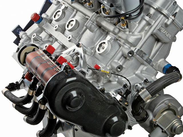 The new Chevy Midget motor uses a belt-driven dry sump oil pump mounted on the right side of the engine, providing easy access for maintenance and protection from exhaust heat.