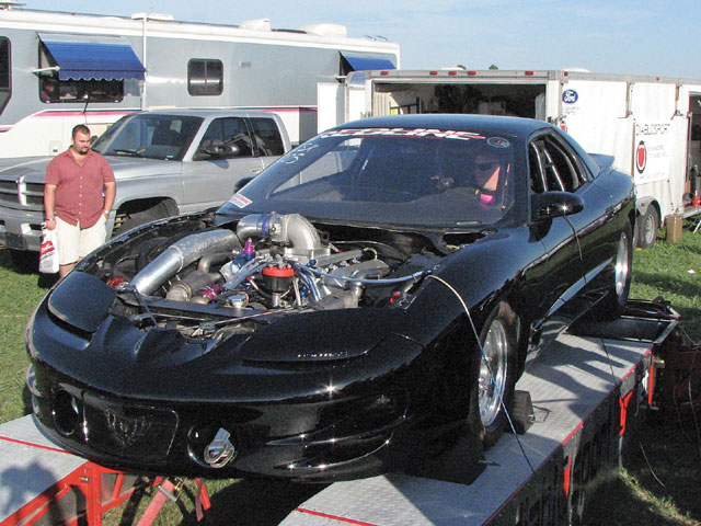 During the LSX Dyno Shootout, this '98 Firebird, owned by Wade Stevens of Pickering, Ontario, Canada, spins the rollers, resulting in 1,064 hp and discovering a hurt fuel pump. Wade borrowed a fuel pump, and was then able to go rounds in the LSX Drag Radial class. The winning 1,146 rwhp figure was posted by Drag Radial Runner-Up Paul Major.