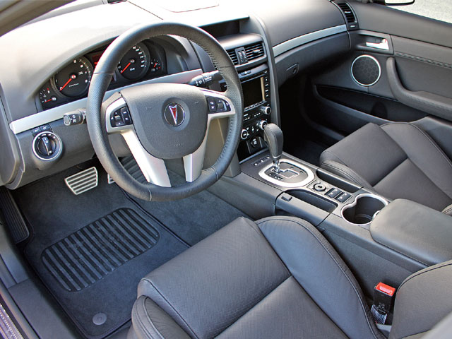 This car has the optional sport metallic pedals, as well as the leather-wrapped Sport steering wheel. Every inch of the interior is covered with fine leather or nicely texturized plastics. The door levers, however, seem like they were made from a plastic mold, and feel cheap. Little things such as incorporating the parking brake into the console, and the user-friendly steering wheel controls make for a pleasant stay inside the cabin.
