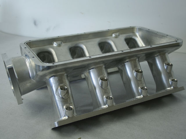This intake manifold was CNC-machined from a solid chunk of billet in-house at GM-no welding. Note the double row of injector bungs: The engine was originally equipped with 16 injectors, one set for cruising and another for WOT. That setup was replaced with a single set of eight 160 lb/hr injectors to simplify fuel mapping.