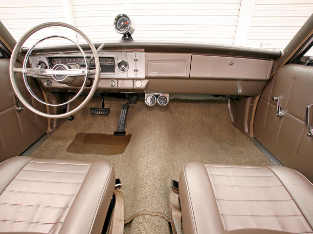 In 1965, the color was attractive and it included details in the seat covers and trim panels that added interest while not adding weight. The rear seat was deleted, and a cardboard panel covers the area where the seatback was previously located.