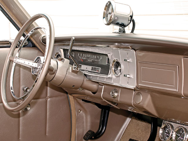 The instrument panel features a heater- and radio-delete. Also missing is the control for the blower switch; the hole has been capped with a decorative stainless steel plug. An era-correct Sun Super tach is attached to the top of the instrument panel-redline 6,500.