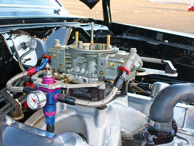 Thanks to a minor carburetor fire, Doug's custom Holley 750 wasn't installed during the shoot. This Holley was provided by a fellow Mopar owner to get the car rolling, demonstrating just how friendly Mopar guys are.