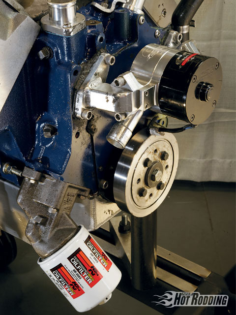 John showed off some of his creativity by adapting a CSR Chevy-style electric water pump to fit the Caddy engine. The MTS harmonic damper up front does a much better job of protecting the crank than any of the 30-year-old OEM dampers.