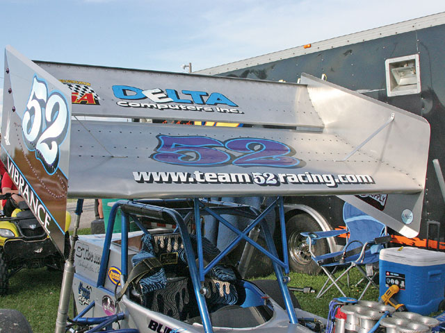 The most striking feature of a Supermodified is the monster wing that sits atop the car. Adjustable gas filled shocks control the angle and pitch of the wing and also allow it to move while on the track. In the straightaways the wing lies flat for aerodynamics. In the corners it pops up for added downforce.