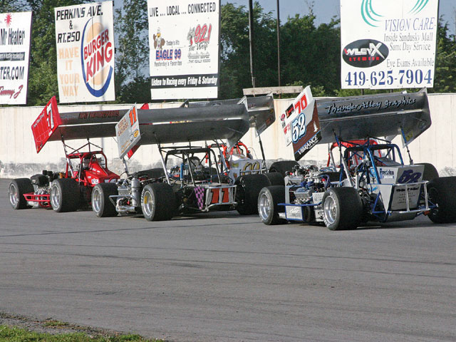 Supers scream down the backstretch at Sandusky Speedway. Look closely, there are five cars in this picture.