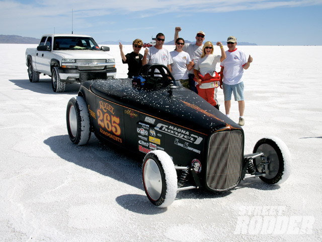 A family affair: without sponsorship, lakes racers rely on family and friends for support crews. From left to right, that's Jerilyn's mom, Judy, Joe Kugel, Jeff Kugel's daughter, Jourdin, Jeff Kugel, Jerilyn herself, and her dad, Jerry. You'd be hard-pressed to tell that they drove the very car home that they raced on the Salt.