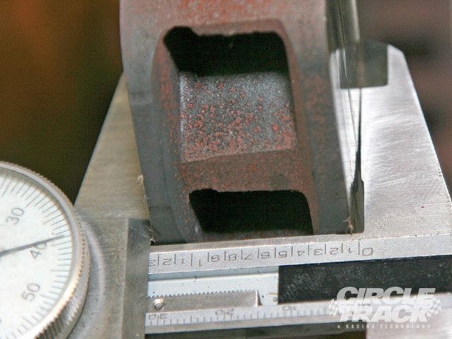 This rotor showed irregular wear. The outer portion of the rotor was thinner than it was 1 inch in toward the center. A flexing caliper was the likely culprit. Note the gap in the back edge of the arm on the dial calipers.