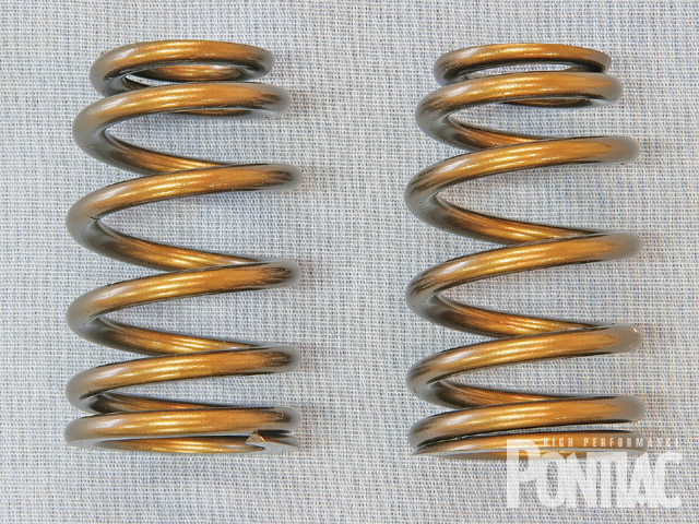 Conical-shaped springs start with a wide base and taper toward the top, while beehive springs, such as these from Comp Cams, are mostly cylindrical, tapering over the top two coils. The appearance and function of the two types is similar.