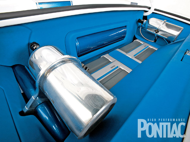 Two 2 1/2-pound nitrous tanks are mounted in the trunk and provide the juice to amplify this Firebird's power output by 400 hp. Also seen are the Air Ride air tank and Infinity amplifiers.