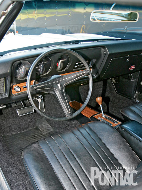 The interior remains factory-fresh and largely original, owing to the ultra-low mileage and decades of indoor storage. The only items needing replacement were the carpet and the headliner, both of which came from Ames Performance Engineering.