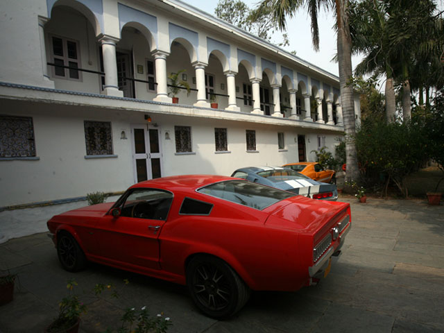 The Equus Mustang, Brittany Blue GT500, and George and I's '70 GT500 in the courtyard of the palace. Talk about fishes out of water.