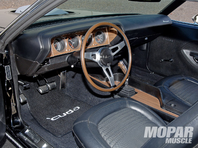 The interior was left unmolested except for a few upgrades. With all the custom, crazy interiors seen in E-Bodies these days, Bill didn't want to go down that same road. A simple Pioneer audio system plays the tunes as he cruises down the street shifting his Tremec 5-speed with the pistol grip.