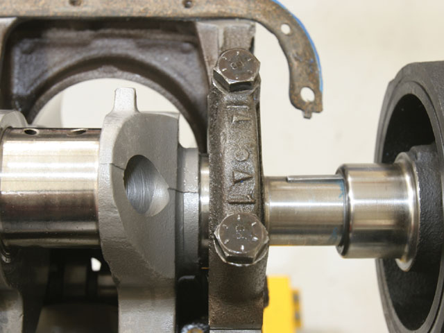 The rods and the main bearing caps are marked for location. The arrows point toward the timing chain and are marked in sequence. We torqued the mains caps to 70 ft-lbs.