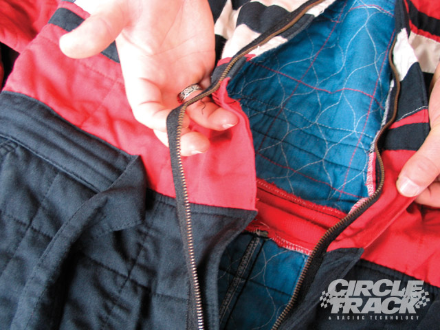 This firesuit needs repair, but a common mistake is to take it to a seamstress who does not have Nomex or fire-retardant thread. In repairing a firesuit, it's essential to use Nomex thread. Short-cutting here, increases your chance of getting burned in a fire.