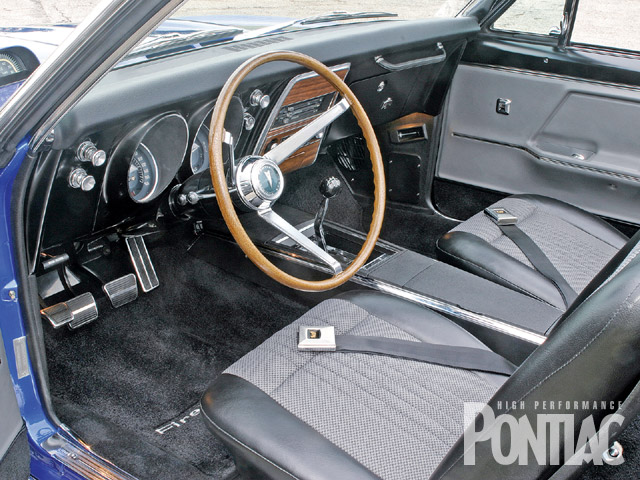 Although the interior looks mostly original, cloth upholstery and matching door panels were designed to keep the heat down on hot summer days. Notice the factory custom sport steering wheel and custom interior accoutrements.