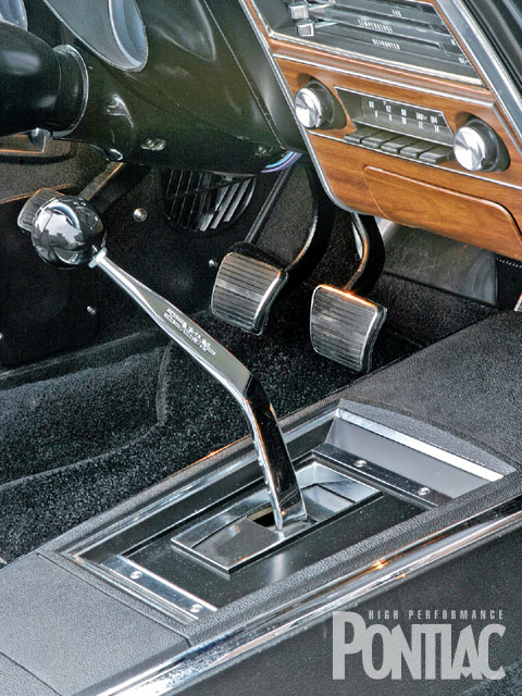 All manual-trans Firebirds came factory-equipped with Hurst shifters. This aftermarket Hurst example controls a Tremec TKO-600 five-speed manual trans. The shift knob has been updated to reflect one extra forward gear, but the console is an original option to this Bird.