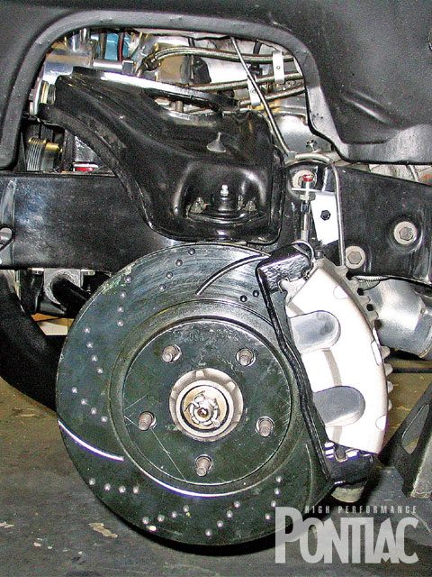 After our photo shoot, John upgraded the original disc/drum braking system with the Fourth-Gen, two-piston calipers and 11-inch rotors shown here. It's controlled by a Hydratech hydraulic-assist unit (not shown) and a GM master cylinder and proportioning valve.