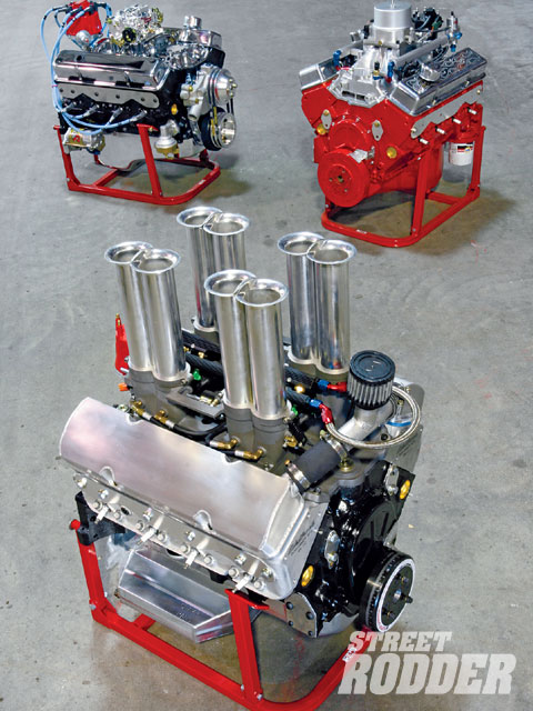 Clockwise from the left rear is the JR Motorsports engine trifecta: the Classic 350, Stage I, and Stage II. With a reconditioned block, crank, and rods, cast pistons, mild cam, either new or used GM heads, and a carburetor, the Classic 350 produces 330 horsepower and has a torque curve as flat as, well...Iowa. The Stage I engines like the one at the top right typically feature longer strokes, aftermarket cylinder heads, and forged pistons, but no two are exactly alike on account of the engine's intended application and induction system (this one's port injected). They're basically higher-output semi-custom offerings. The Hilborn-injected engine in the foreground is typical of a Stage II in the sense that it's unique to itself. It's a 500-horse long-rod stroker for a McLaren racecar that sees equal time on the street and at vintage-racing events.