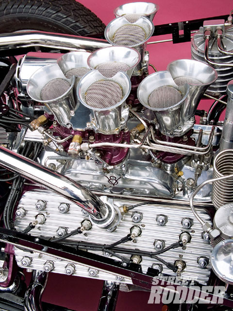 The intake is a '35 Alexander set up to accept the unusual combination of four Stromberg 97s.