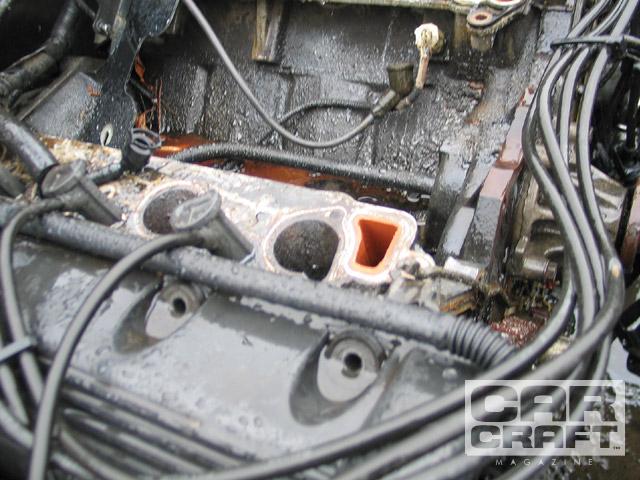Aside from identifying the year of the vehicle, the quick way to spot a non-PI 4.6L engine is the intake port. Note the shape of the intake runner is circular compared with the rectangular PI head.