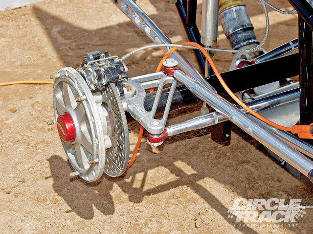 The steering system for Sprint Cars use a steering box located just in front of the steering wheel, and a connecting link that runs from the box's steering arm up to the front spindle steering arm. As the car rolls, the vertical movement of the rear of the connecting link causes the front wheels to steer. Bob Bolles