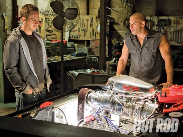 That's a real 528ci Hemi under that BDS 8-71 blower-others used 350 Chevys with phoney blowers. The hero Charger was built for close-up scenes and did not do many stunts. It would be one nasty bastard to actually drive. Paul Walker and Vin Diesel are shown here.