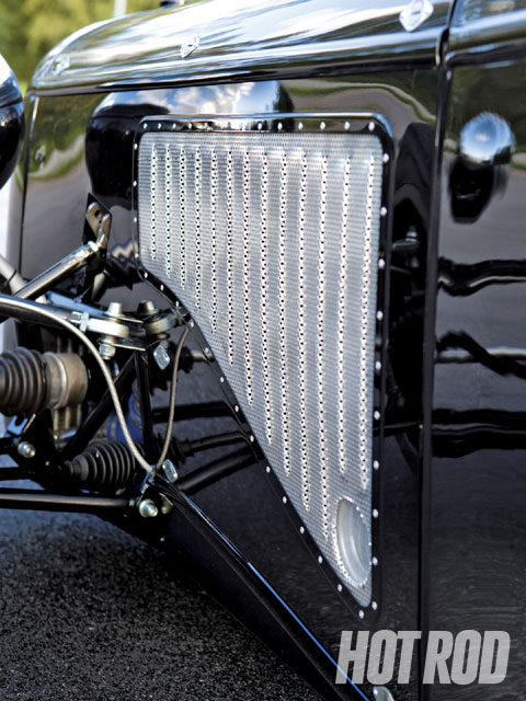 Perforated aluminum was chosen for the hood sides to cool the engine more efficiently, but Tomas formed ribs into it as a nod to the louvers on a '32 Ford hood.