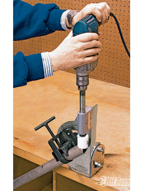 Eastwood's pipe notcher/tubing cutter (PN 21749) costs $79.99, and is a necessity for cutting and fitting rollbar tubing and chassis components. The compound angle adjustment is clearly graduated in degrees for accurate, repeatable cuts. Rectangular stock can also be accommodated.