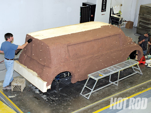 Here, a full-scale clay model is being developed for a prototype electric van in Special Projects' clay studio. Company artisans can work from styling drawings or CAD files to realize the designer's vision.