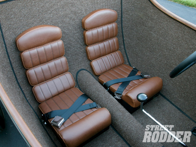 The unique seats that form to the backside of the cockpit were done in saddle brown vinyl from Tritex but designed and installed, along with the square-weave wool carpet, by the owner.