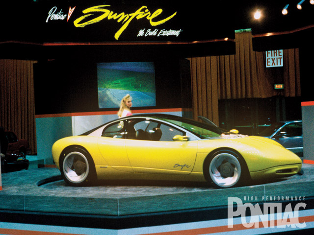Looking like a coupe but having four doors was the '90 concept from Pontiac, the Sunfire. With a carbon-fiber and mostly glass roof, it was void of exterior trim and even door handles. A front driver with 190hp four, it introduced the Sunfire name long before it was used on a production car for 1995.