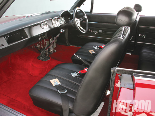 Stock restoration pieces from Year One and Just Dashes blend seamlessly with custom upholstery and carpet by Eric Thorsen Custom Upholstery. Note the dash has been flattened and reshaped. The glovebox actually hides fuses for critical circuits.