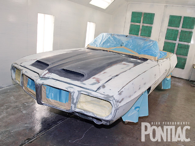 Here is what Classic Restorations started with: '69 Firebird convertible that was not only treated to a custom nose, headlights, and tail section, designed by company owner, Melvin Benzaquen, but also a House of Kolor Tangerine Kandy urethane enamel paint system. At this point, the Pontiac has been cleaned with HOK KC10 Wax and Grease Remover, and the bodywork has been completed and block sanded with 320 grit using a guide coat until all panels were deemed straight. About 50 labor hours are usually spent on this process. The Bird was then masked and the shell was wiped down with HOK Kosmic Kleaner to remove sanding dust and light contaminants. After allowing it to dry and then wiping it with a tack cloth, the Pontiac was ready for the first application of the HOK paint products.