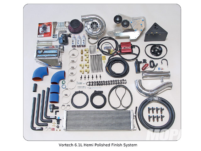 The major components of the Vortech package include a compressor, Power Cooler, pulley bracket, belts, hoses, air filter and water tank. Either satin or chrome finish is available. (Not shown is the Diablo programmer for recalibrating the engine computer.) The system shown here was installed on a 5.7 Hemi, and the basic steps are fairly similar across all Dodge and Chrysler models, with only a few minor variations, which are highlighted below.