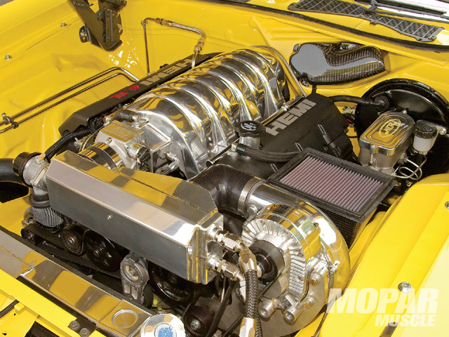 It looks a little tight but actually, this Paxton supercharged and intercooled 6.1 liter Hemi fits very nicely in this 35-year-old engine bay. The installation is super clean.