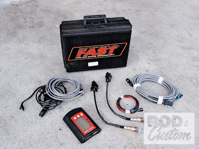 The FAST dual sensor O2 air/fuel meter kit comes with a pair of O2 sensors, a lighted graphic display screen with built-in data logging facility, outputs for external data loggers, digital gauges, and a narrow-band simulator function that allows you to feed your engine's computer a factory signal while using the wide-band sensor for air/fuel measurement (not that we needed this on our carbureted engine). The meter takes its power from the vehicle's cigarette lighter to make it truly mobile.