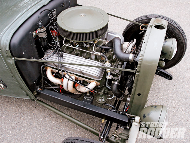 We love small-block Chevrolets because; A) they're cheap, B) they go fast real easy, and C) they make snobs whine. This one's a standard rebuild with hogged-out 327 swap-meet heads, a no-name cam, and a mild Edelbrock/Holley induction system.