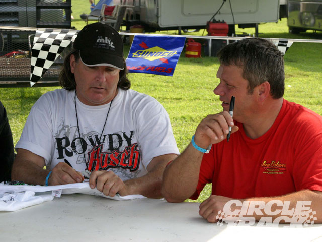 Scott Bloomquist (L) and Don O'Neal (R) started thier day with the fans signing autographs at Florence Ky. At the end of the day they finished second and third in the North South 100 race.