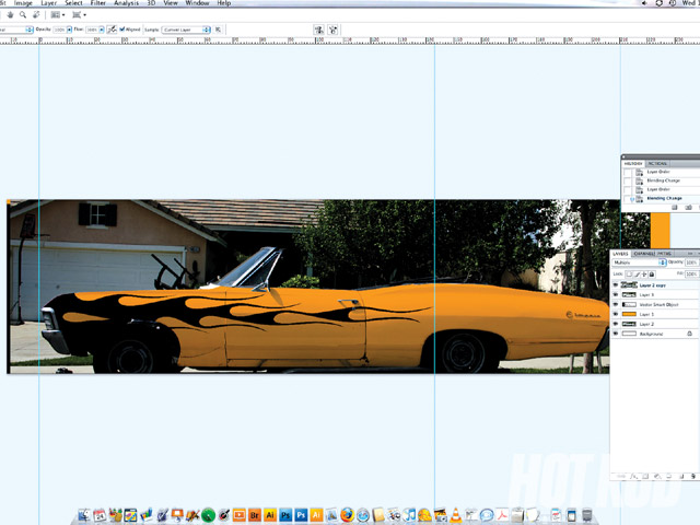 Also in Photoshop, a real image of the car was used to give us an idea what the graphics would look like once installed. We thought this orange-and-black idea might work but rejected it once we saw this. After we approved a final design, it was printed on sheets of white vinyl. Each side of the car's graphics is an exact mirror image of the other.