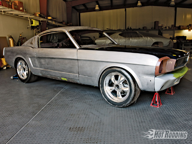 This is what they had to start with. It's a stock fendered '66 Mustang Fastback. The original wheel openings don't fit the racer look Jeff Lilly was going for.