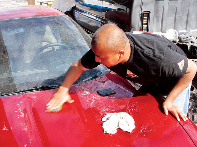 Color-sanding a factory clearcoat is not recommended. In this case, Santini has just repainted the hood on this Corvette, which gives him the luxury of several layers of clear to work on.