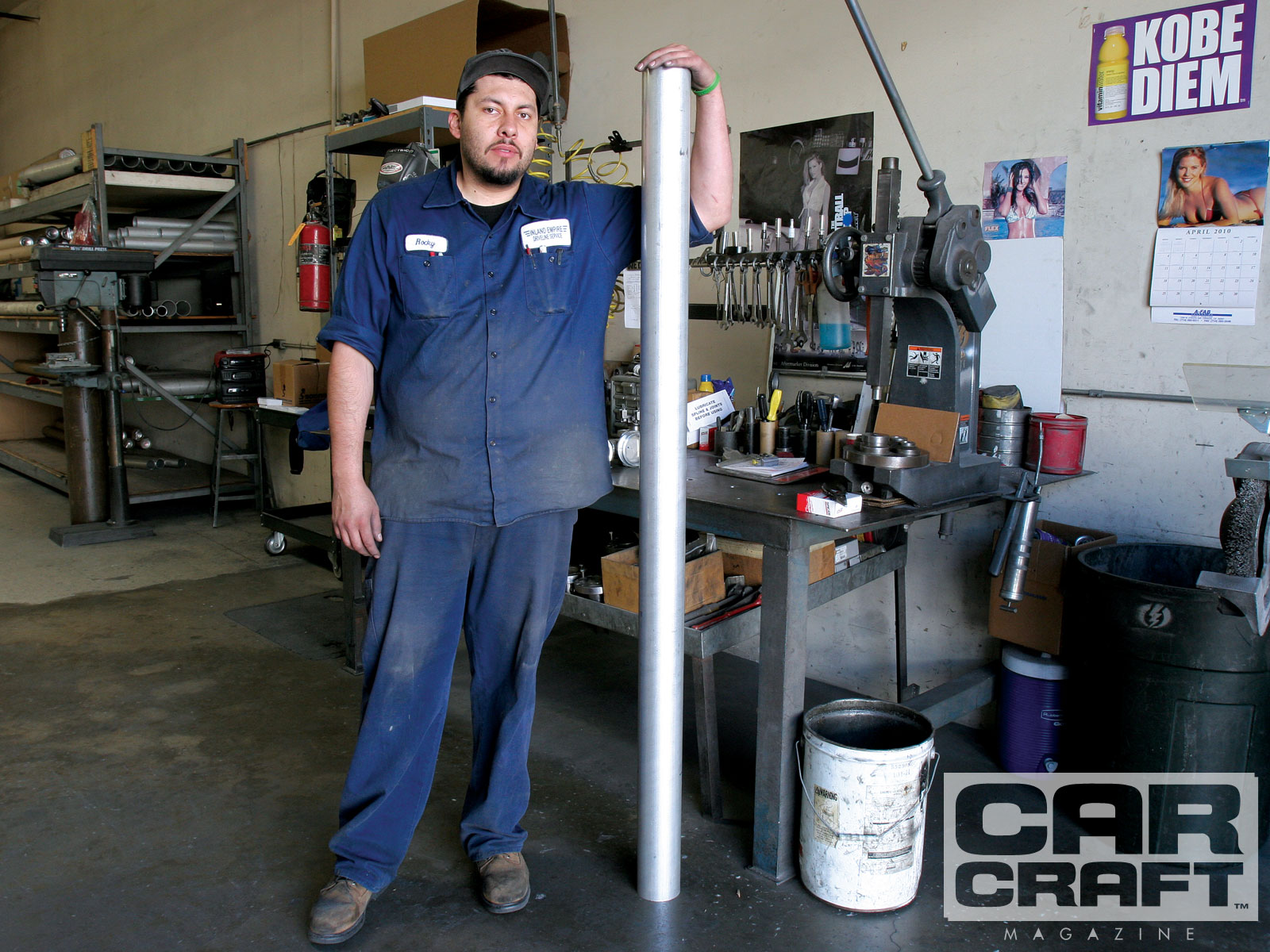 F. Rocky Maldonado is holding a 6061 T6 aluminum driveshaft tube. Stock vehicles used to have mild-steel tubes standard but now it's not uncommon to see a factory aluminum driveshaft in a performance car. The next step up is chrome-moly then carbon fiber for all out performance and price. Likely, aluminum will fit your performance needs.