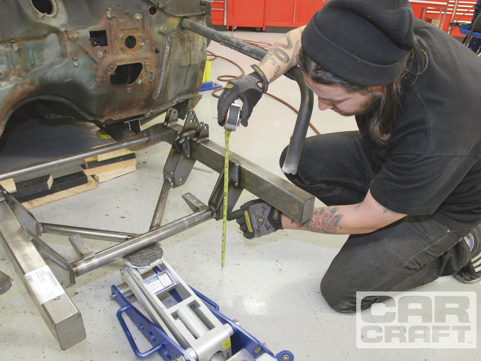 The next measurement is the height of the framerail from the ground. Chassisworks provides a blueprint with each frame, which has this information. We measured from the ground to the bottom of the steering rack mounting bracket and from the top of the frame to the ground and compared the numbers with the blueprint.