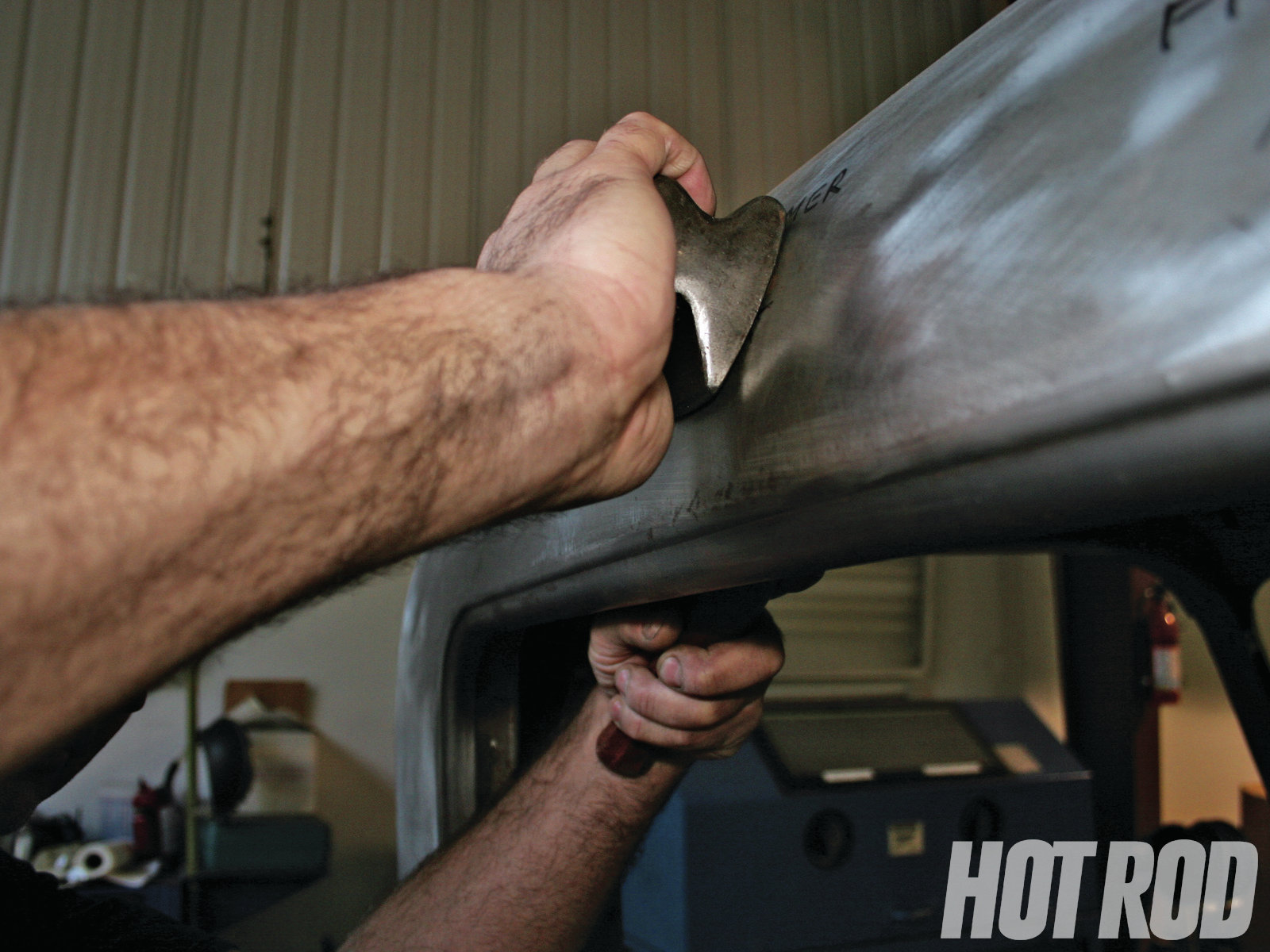 Make a nice swing with the hammer and make even contact with the panel. How you hold the dolly is important. Just 1⁄8 to 1⁄4 inch inside the dent, away from where the hammer strikes on the outside of the dent is best. This will allow easy dent removal without having to strike the panel so hard. In fact, a gentle, bouncing hammer swing is better. When the dent is about 80 percent removed, move to the slap-file method.