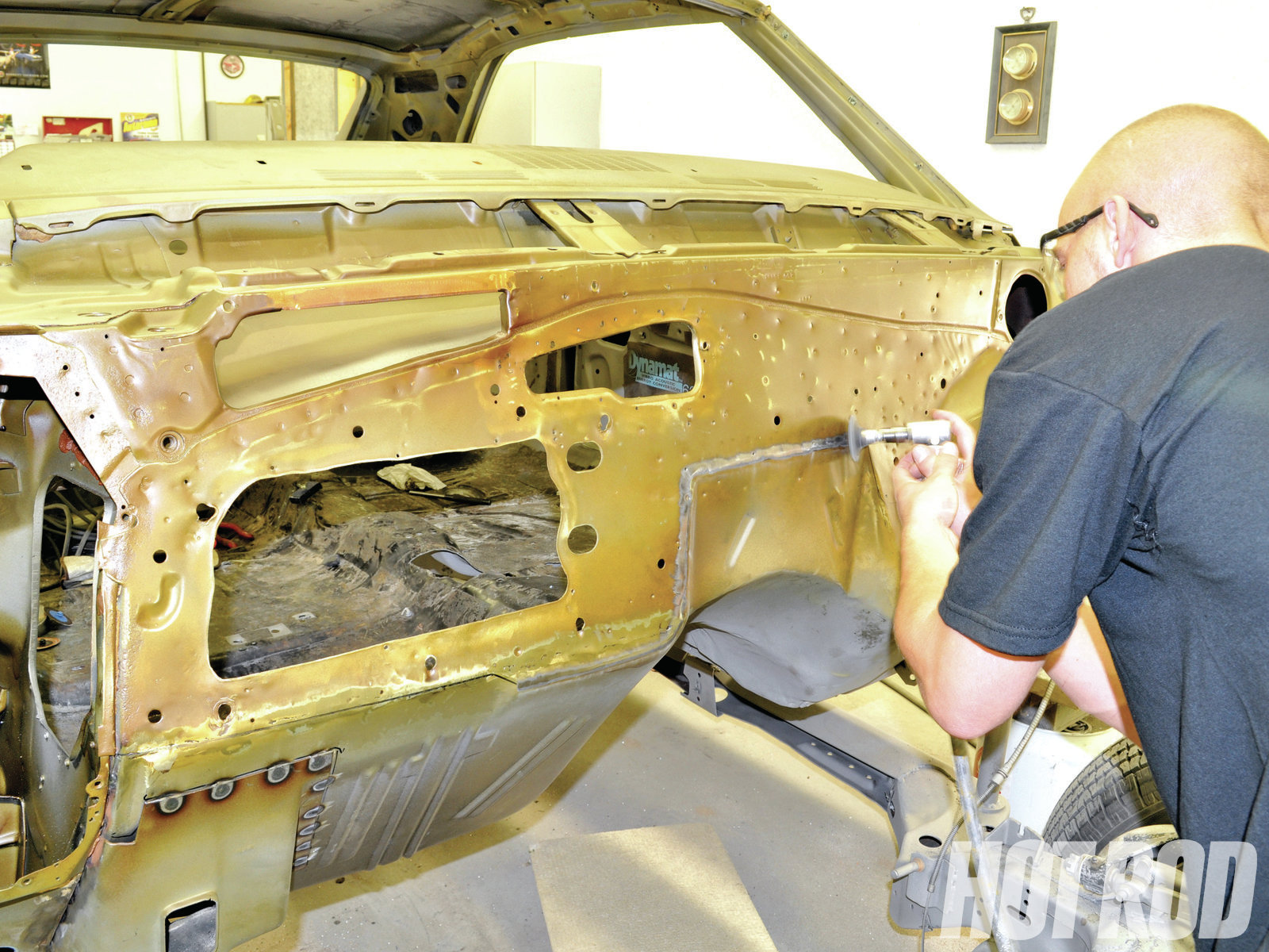 A fresh coat of PPG Self Etching Wash Primer was applied over the original firewall to protect it from corrosion. The Smoothie Firewall Panel was held in place with Clecos and traced yet again. With the panel removed, Grzelakowski sanded the primer around the panel edges to expose bare metal for welding. You'll also need to prime the backside of the new panel and then clean several areas where you'll tack-weld from the backside.