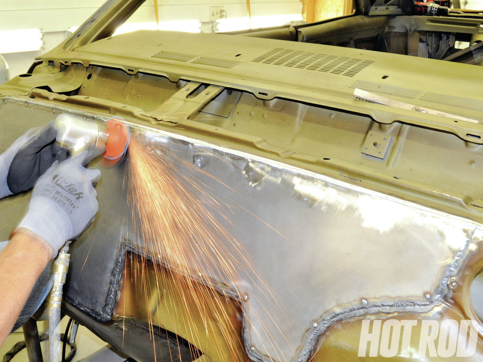 Once the edges of the panel are welded, you can remove the Clecos and fill the small holes with a MIG welder. The final bit of metalwork is grinding the welds smooth. You'll probably need a thin layer of body filler in some spots.